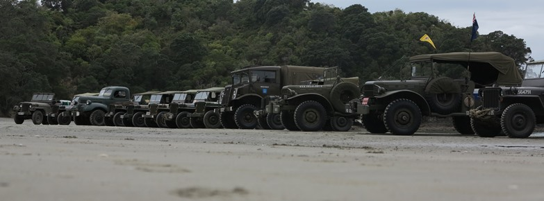 Military vehicles lined up on the beach