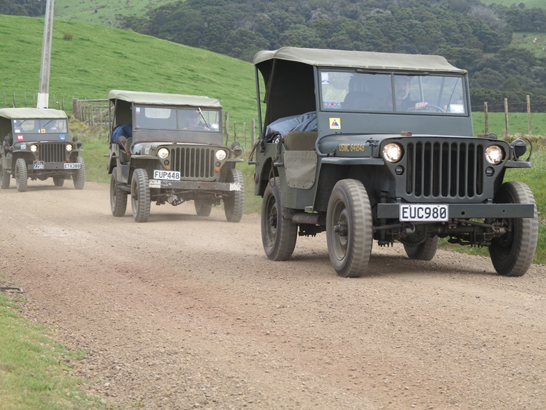 The convoy powers up a hill