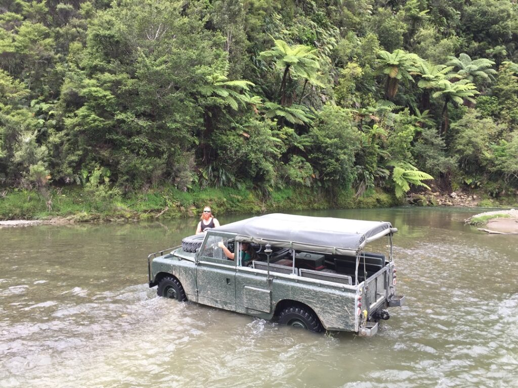 Paul guides a land rover across the river. #nzmvc #landrover New Zealand Military Vehicle Club Inc
