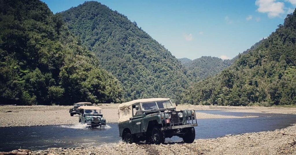 Land rovers crossing and emerging from a river. East Cape. #nzmvc #landrover New Zealand Military Vehicle Club Inc