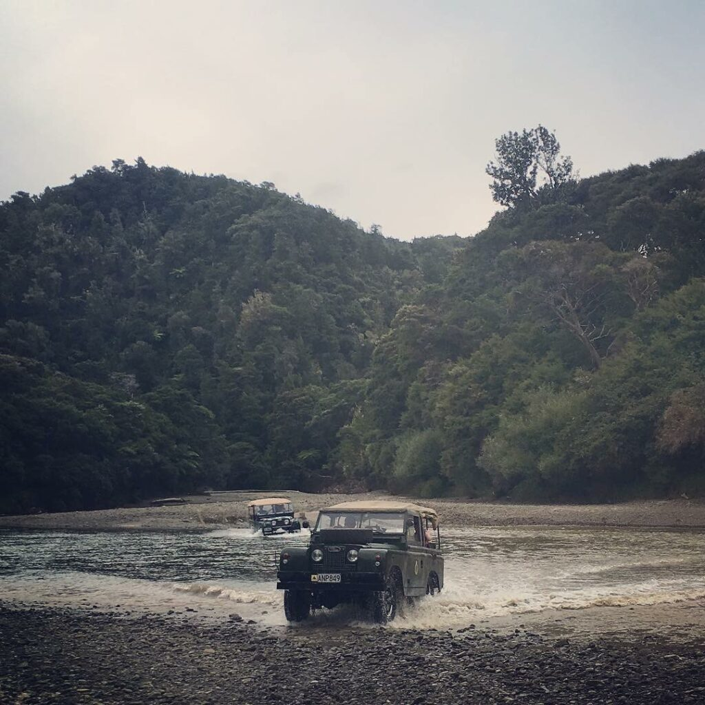 Series II landrovers crossing a new zealand river. Native bush on hill behind. #nzmvc #landrover New Zealand Military Vehicle Club Inc